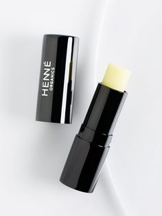 Luxury Lip Balm V2 | **Henne Organics**    Deeply moisturize and nourish lips with this all-natural balm in a sleek black tube that's perfect for use on-the-go. Crafted from a blend of organic ingredients, this formula hydrates and heals to a luxe, healthy finish.  *  0.17 fl. oz.   * Intended for all skin types.   * **How to Use:** Apply liberally on the lips for maximum benefits