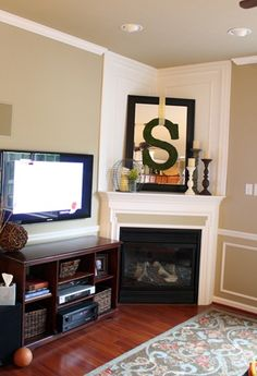 Love the mirror with the monogram on top of the fireplace.