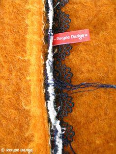Oranje wollen krukje - close up