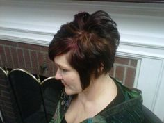 Asymmetrical hair cut...with dark red violet  with highlight pieces with Red Violet Socolor by Matrix