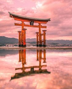 The sacred island of Miyajima is one of the top scenic spots in southern Japan. L'île sacrée de Miyajima est un incontournable de tout voyage dans le sud du Japon. Photo Japon, Japan Photo, Wallpaper Paisajes, Places Around The World, Around The Worlds, Beautiful Places In Japan, Japon Tokyo, Torii Gate, Hiroshima Japan