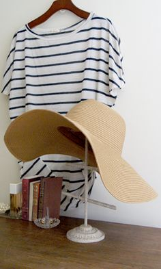 "Nothing says ""welcome fun and sun!"" more than a great floppy straw hat. In the perfect ""wet sand"" color no less. It's up to you on what style to take on. Wrap a vintage printed scarf for fabulous retro flair or a simple grosgrain ribbon for an earthy relaxed look. Wear it to a dreamy resort or a breathtaking beach. Make sure this perfect sun hat is on that cruise you've been planning for months. No matter where the sumer takes you you'll be sure to look sensational with superb protection!"