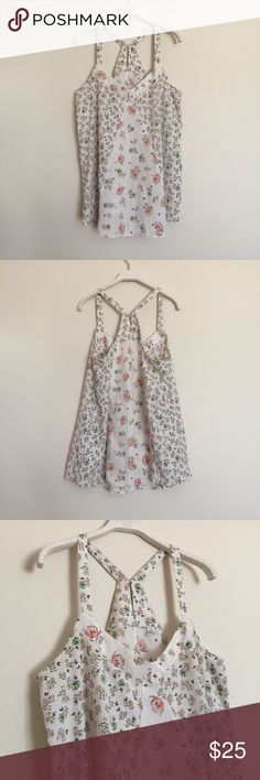 """White pink floral patterned sleeveless blouse M Adorable blouse with keyhole button back. Two floral patterns in a flowy cut. Excellent condition. Pit to pit 18"""", length 27"""". Bundle to save 25%! Anthropologie Tops Blouses"""