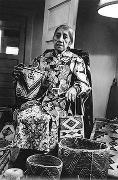 Elderly Yakama woman with baskets and bags, Washington, ca. 1908