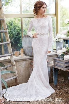 Classic, timeless, and sophisticated, Tara Keely 2653 is a stunning wedding dress with a bateau neckline and long sleeves.