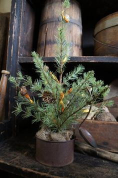 you can never have enough Prim Christmas trees around the house. I love the tin cup as a holder!!