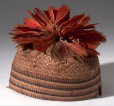 Africa   Chief's hat from the Mangbetu people of Medje, Belgian Congo   Plant fiber with bunches of the red tail feathers of the gray parrot   ca. 1915