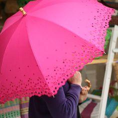 Pink eyelet umbrella.
