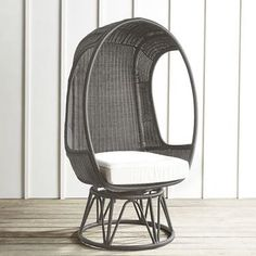 """Once again, we've used the model of our iconic Papasan to develop a chair that's as fun as it is comfortable: The Spinasan™. Constructed of hand-woven, all-weather wicker over a rust-resistant, powder-coated metal frame, our egg-shaped chair is attached to a swivel base for all-around merriment—indoors or out. <span id=""""mini-upsell"""" data-launch=""""true"""" data-required=""""false"""" data-product=""""Cushions"""" data-masters=""""PV..."""