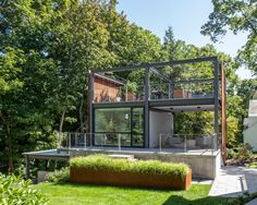 Flavin Architects has built a three-storey addition for a house in Massachusetts to offer space for a couple to write, garden and repair antique scooters. Indoor Outdoor, Outdoor Living, Outdoor Rooms, Dutch Colonial Homes, Modern Lanterns, Wood Cladding, Patio, Residential Architecture, Timber Architecture