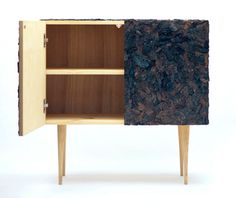 South Korean product and furniture designer Xerock Kim created a wooden cabinet covered in bark. Named Accumulation, the piece symbolizes the place at which tradition and modernity meet.