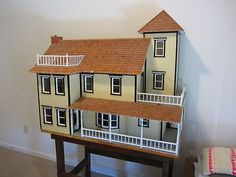 Victorian Dollhouse | eBay I am amazed someone is asking $800 for this on eBay. The only reason I pinned this is because it is the same model of dollhouse I have from the 80's.  The people who are trying to sell this for a fortune did not put it together very well. Totally hosed the stairs inside etc.