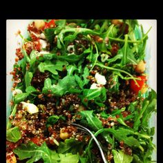 My own recipe :) Peppery arugula, diced tomatoes, chick peas, red quinoa, diced green or red onion, mozzarella or goat cheese, fresh lemon juice and a homemade pesto vinaigrette! Sea salt and cracked pepper to test! Seriously- my lunch EVERYDAY! Looooove!