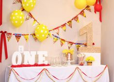Cheerios 1st birthday party {simply darling!}: #1 pinata was painted and covered in Cheerios, clear vase filled with Cheerios and #1 candle, cereal box bunting, garlands of red ribbon/yellow pom poms/Cheerios on a string, wooden spoons dipped in white chocolate and sprinkled with Cheerios