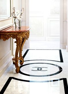 """Wouldn't this be the most perfect dressing room floor? Of course, we're all familiar with that oh-so-famous Chanel logo ...  but if this floor were in a dressing room, we'd also clearly hear these """"C"""" words, in Chanel-speak,  floating somewhere in the air ...  """"Closet Chic"""""""