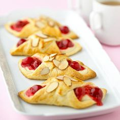 With this quick and easy recipe, you can treat your family to fresh-baked Danish pastries any day of the week. The timesaving ingredients are refrigerated crescent roll dough and cherry pie filling. Just Desserts, Delicious Desserts, Yummy Food, Breakfast Recipes, Dessert Recipes, Breakfast Ideas, Dessert Ideas, Brunch Recipes, Yummy Treats