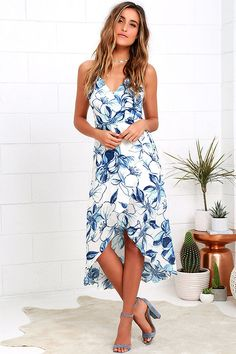 Take a twirl in the Wrapped in Whimsy Blue and Ivory Floral Print High-Low Dress and feel instantly uplifted! Ultra-soft woven rayon, with a blue floral print, falls from skinny straps into a surplice bodice with strappy back, modesty button, and waist tie. Wrap skirt has a high-low hem.