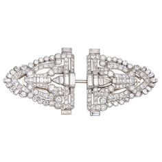 Art Deco Diamond Platinum Dress Clips | From a unique collection of vintage brooches at http://www.1stdibs.com/jewelry/brooches/brooches/