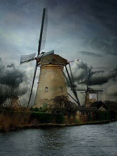 Dutch windmills in Holland, The Netherlands.) These windmills are really beautiful working works of art especially compared to the modern ones. Holland Windmills, Netherlands Windmills, Holland Netherlands, Eindhoven Netherlands, Tilting At Windmills, Le Moulin, Delft, Beautiful Places, Beautiful Pictures