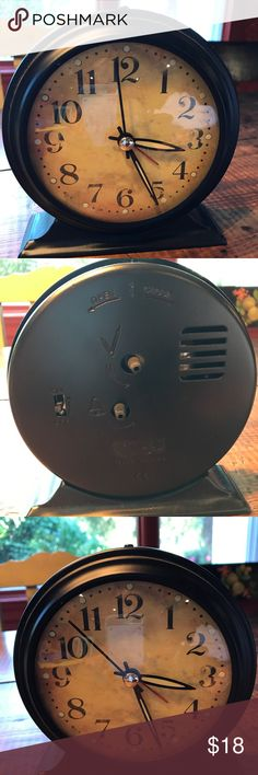 Bronze vintage style alarm clock Bronze table clock. Features glow-in-the-dark tips on the hour and minute hands. Requires one C battery (not included). Back plate has easily screws off for battery installation.  Alarm clock function. 6 inches high about 5.5 inches wide Accessories Watches