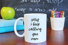 Ummm... yeah... sorry I keep calling you mom! Lets face it. Lets face it. Your kid is getting pumped full of knowledge, theyre antsy, and theres one name theyre used to shouting 1564 times a day... MOM! This teachers gift is sure to get a gift. It makes a great Christmas gift for teachers, or a just-because gift!  This coffee mug holds up to 11 oz of yummy goodness. It is designed with permanent ink that is dishwasher safe! This item is made to order and ships within one week.