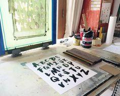 Hand screenprinting our Brushed Alphabet design