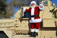 Santa climbs on board a joint EOD rapid response vehicle (JERRV) for the Explosive Ordnance Disposal Group One Children's Christmas Party held on board Naval Amphibious Base Coronado. (U.S. Navy photo by Lieutenant Commander Donnell Evans/Released)  Read more: http://www.dvidshub.net/image/1068592/holiday-jerrv#.UqdVb41Q1ak#ixzz2n60JgRSq