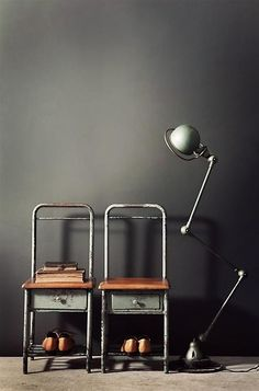 Industrial metal and timber chairs with drawers and the perfect Vintage Jielde lamp! #LaBoutiqueVintage