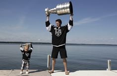 Like father, like son...Colin Fraser and his son, Calder, hoist Stanley Cups together at Sylvan Lake via the Los Angeles Times