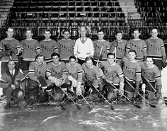 The 1934 New York Rangers pose for a team photo at Madison Square Garden. Front row (l. to r.), Harry Westerbake, A. Aitkenhead, Cecil Dillon, Art Sommers, Vic Ripley, Frank Boucher, Murray Murdoch, Brennan.Rear (l. to r.) Earl Seibert, Heller, Osmundson, Dutskowski, Patrick, Bill Cook, Ben Cook, Keeling and Ching Johnson.