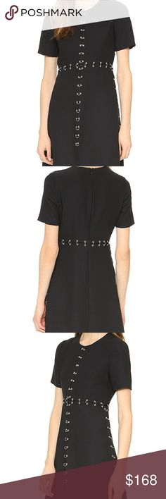 The Kooples Rings On Crepe Black Satin Dress Perfection!  DETAILS  Polished rings and grommets link the divided panels on this striking The Kooples dress. Round neckline. Short sleeves. Hidden back zip. Lined.  Fabric: Mid-weight crepe. 100% polyester. Dry clean. The Kooples Dresses Mini
