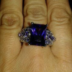 Amethyst cz ring Emerald cut stone about 4 CT Sterling silver  With amethyst stones in sides of ring for that extra added bling. Size 7 Jewelry Rings