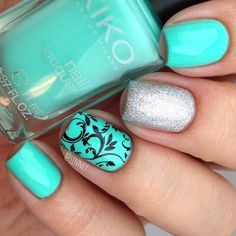 I bought 3 almost identical mint green nail polishes from my recent trip to Barcelona. Oops. This is the 2nd of them, 389 Mint Milk by Kiko. The formula was amazing on this one and it's a near dupe for CC's Blue-Ming. Middle finger is #thisgownneedsacrown by OPI and ring finger is stamped with @bundlemonster #bm023 plate • #sinneybarcelonahaul #kiko389 #389mintmilk #kikonails