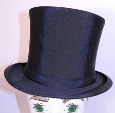 Vintage Kennedys Victorian Gentlemen Black Silk Collapsible Opera Top Hat. This vintage Victorian era Kennedy's gentlemen's black silk collapsible opera top hat dates from 1900. $150