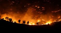 A wildfire burns between Lake Isabella and Wofford Heights, Calif. on June 19, 2012. (Casey Christie/The Bakersfield Californian/Associated Press)