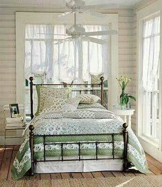There's a beauty to wrought iron that compliments any home interior. Placed right, this unique style can make just the difference in a room. Wrought iron beds give a fresh, nostalgic. Cozy Bedroom, Bedroom Decor, Beach Cottage Bedrooms, Country Cottage Bedroom, Master Bedroom, White Bedroom, Bedroom Wall, Sleeping Porch, Cottage Interiors
