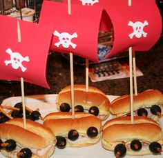 Pirate Ship Hoagies - Deli sandwich on a hoagie, stick 3 pretzles in on each side (as canons) and add an olive to each pretzel.  Add the sail and flag and you're ready to eat.  Could also be done with hotdog.