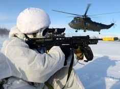 Royal Navy Sea King helicopter from 845 Naval Air Squadron on winter training ops with Royal Marine Commandos in Northern Norway, 200 miles inside the Arctic Circle. (RN photo Mez Merrill) posted by Charles McCain 12 Tribes Of Israel, British Armed Forces, National Symbols, Royal Marines, Military Gear, Arctic Circle, Public Service, Modern Warfare, British Army