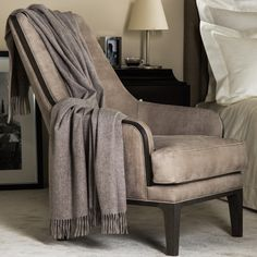 BLISS THROW                   Pure cashmere throw with fringes on short edges. Sourced from the under fleece of Hyrcus mountain goats, Frette cashmere yarns are spun, woven and finished exclusively in Italy. 100% Cashmere. Made in Italy.