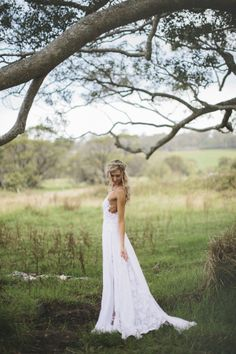 SMP: $1800 Stunning Low Back with romantic French Lace and a mid thigh length silk chiffon skirt.  Romantic and dreamy with floating panels of silk chiffon that move when you walk to show off the under layer of white French lace .