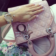 Rolex watch, van cleef apparels bracelet, lady Dior mini bag