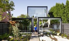 """Austin Maynard Architects designed THAT House, a stunning modest-sized home made deliberately smaller than its neighbors and offers """"just the right amount of space."""""""