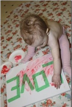 Put tape on canvas,let them finger paint,remove the paint...