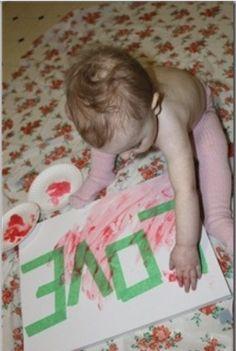 Put tape on canvas,let them finger paint,remove the paint...