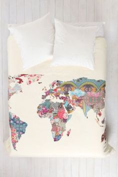 A patchwork of prints create a colorful world map on this stylish duvet cover via #urbanoutfitters #backtoschool #dorm