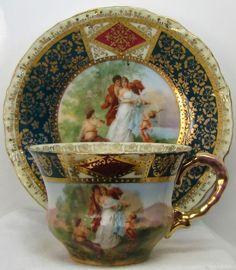 Šálek na čaj * bílý porcelán se zlato modrým okrajem, s ručně malovaným obrázkem r.1930 * Rakousko.