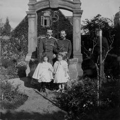 Grand Duke Ernst Ludwig of Hesse and by Rhine with his daughter Princess Elisabeth, and his brother-in-law Tsar Nikolai II of Russia with his daughter Grand Duchess Olga