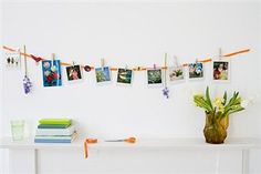 photo's hanging from pegs on a wall  ©Getty Images