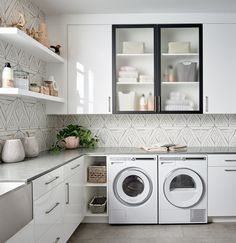Chic white & black laundry with geometric tile | White High Gloss 3DL cabinet doors with Matte Black Aluminum Frames from Northern Contours