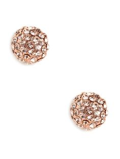 Pave covered studs pack a punch, but their smaller size makes them just right for day or as a subtle accent to a statemen...